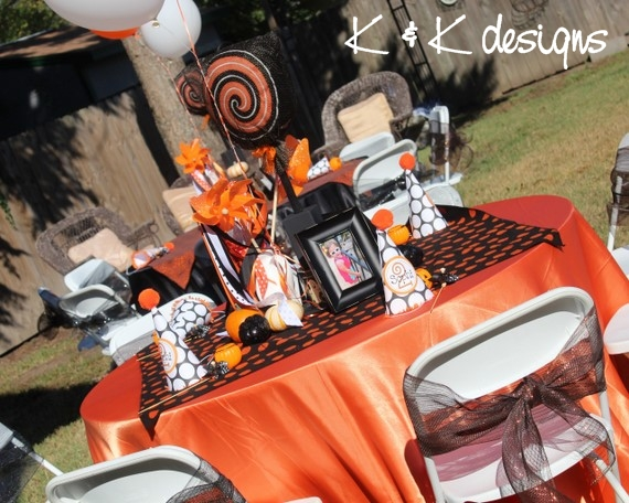 The centerpieces included giant black and orange lollipops Whosie Wands